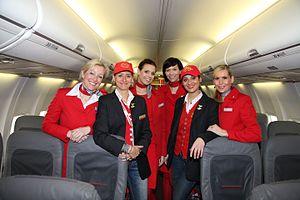 Lauda Air - Lauda Air flight attendants wearing the airline's trademark denim jeans.