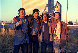 Lawson Fusao Inada - Lawson Inada (left) with Frank Chin, Shawn Wong, and Michael Chan on the set of John Korty's 1976 film, Farewell to Manzanar