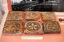 Six decorated medieval terracotta floor tiles, excavated at the abbey