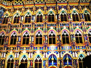 Leuven Town Hall - The town hall at night, lit up by laser lights