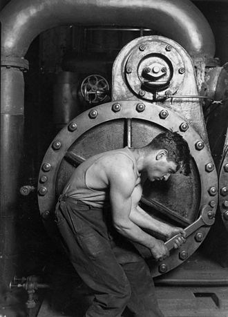 "Lewis Hine - ""Power house mechanic working on steam pump"" (1920)"
