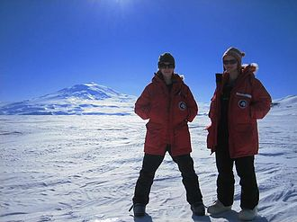 Kelly Jemison - Kelly Jemison (left) and Charlie King (right) stand at the base of Mt. Erebus, Antarctic (2006).