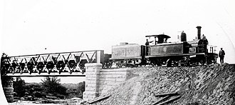 "CGR 2nd Class 2-6-2TT - CGR 2nd Class 2-6-2TT no. M26, with tender and ""front porch railings"", Fish River Bridge, c. 1881"