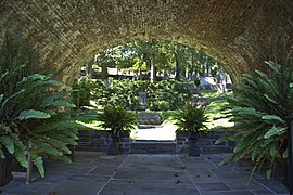 Looking SE through rock bridge - Amphitheater section - Oak Hill Cemetery - 2013-09-04.jpg
