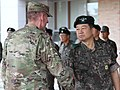 Lt. Gen. Gary Volesky, I Corps commanding general, greets Gen. Woon-Young Kim, Third Republic of Korea Army commanding general after a ceremony.jpg
