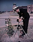 Lt. Joe Steinmetz photographing a camellia bush at NAS Pensacola (9410629694).jpg
