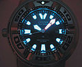 Luminescent paint pigment applied on a diver's watch to make it readable in low light conditions..jpg