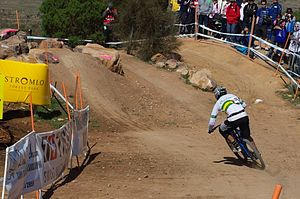 Downhill mountain biking - Australian rider Jared Rando takes the A line at the 2009 UCI World Mountain Bike Championships in Canberra, Australia.