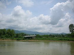 Fishpond in Mae Yao District with the Daen Lao Range in the background