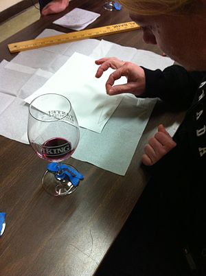 Malolactic fermentation - A winemaker running a paper chromatography test to determine whether a wine has completed malolactic fermentation