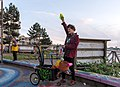 Man using a soap bubble machines on Spyglass Dock during golden hour (DSCF7448).jpg