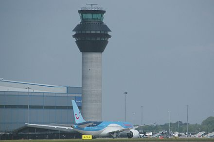The new control tower, opened in June 2013, with a Thomson Airways Boeing 787 Dreamliner taxiing in at the end of its delivery flight. Manchester Airport new control tower.jpg