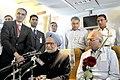 Manmohan Singh briefing the accompanying media on board flight to way back to Delhi after the XVI Non-Aligned Movement (NAM) Summit, in Tehran, Iran,. The National Security Advisor, Shri Shivshankar Menon is also seen.jpg