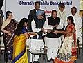 Manmohan Singh presents the new account kit to the first account holder, at the inauguration of the first branch of Bharatiya Mahila Bank Limited, in Mumbai. The Governor of Maharashtra, Shri K. Sankaranarayanan.jpg