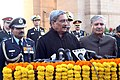 Manohar Parrikar interacting with the media after paying homage to the Martyrs of 1971 War, at Amar Jawan Jyoti, India Gate, to mark the 'Vijay Diwas'.jpg