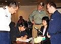 Marine Board of Investigation Members Observe Makoto Oide Draw a Diagram of the Alaska Ranger DVIDS1086480.jpg