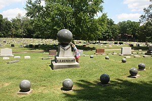 Marion, Ohio - A curious visitor to the Marion Cemetery inspects the moving sphere atop the Merchant family grave marker.