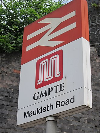 Greater Manchester Passenger Transport Executive - A GMPTE branded signpost at Mauldeth Road railway station in 2013