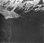 McCarty Glacier, terminus of tidewater glacier, hanging glaciers with icefall on the surrounding mountainsides, September 4, 1977 (GLACIERS 6635).jpg