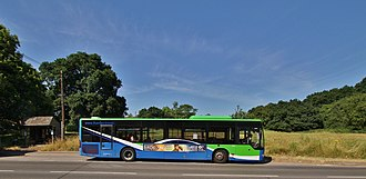 Nettlebed - A Thames Travel bus on route X38 on the A4130 road at The Green in Nettlbed