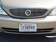 """Mercury's signature """"waterfall"""" grille and logo on the front of a 2000-2005 Mercury Sable."""