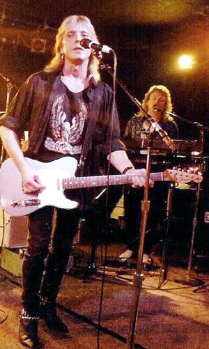Mick Ronson - Ronson (front) during a concert with Ian Hunter, 5 October 1988