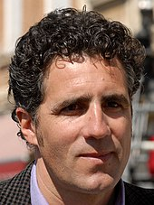A man with black curly hair