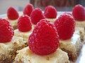 Mini lemon cheesecake squares with raspberries.jpg