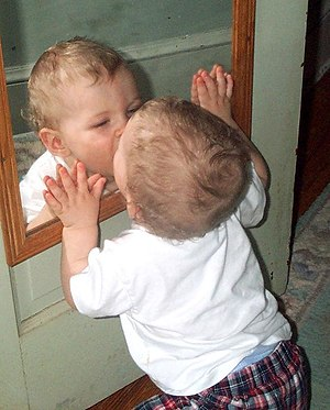 Mirror stage - A toddler and a mirror
