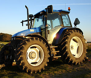 English: A modern 4-wheel drive farm tractor. ...