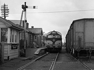 Mogeely railway station - A CIE 001 class locomotive stops at Mogeely with the daily (Mon-Fri) Cork - Youghal freight on 22 April 1977