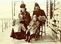 Mr & Mrs J Acklen with their two children, Charlotte and Joe, on the front porch of their home, Dawson, Yukon Territory, ca 1901 (MEED 148).jpg
