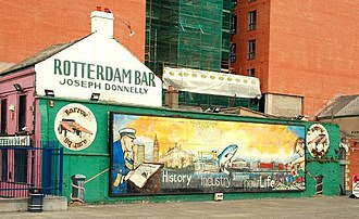 Sailortown, Belfast - Mural painted on the gable wall of the 19th-century Rotterdam Bar, corner of Pilot Street and Barrow Square close to the Clarendon Dock. In recent years, the pub has been a popular venue for live music.
