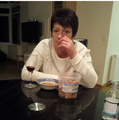 My mother eating nigerian chin chin ... she loves it ... goes well with red wine lol.png