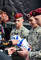 NASCAR driver Clint Bowyer signs ball caps for Army Sgt. Chase Noble, a mechanic with the Company E, 1st Battalion, 508th Parachutist Infantry Regiment, 4th Brigade Combat Team, 82nd Infantry Division, Spc 121028-A-ZZ999-003.jpg