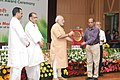 Narendra Modi presenting the NASI-ICAR Award for innovation and research on Farm Implements 2013 to the Orissa University of Agriculture and Technology (OUAT).jpg