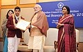 Narendra Modi presenting the National Bravery Awards 2015 to the children, in New Delhi on January 24, 2016. The Union Minister for Women and Child Development, Smt. Maneka Sanjay Gandhi is also seen (12).jpg