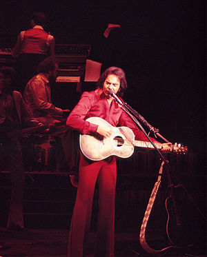 Neil Diamond - Diamond performing on opening night of the Theater For the Performing Arts at the Aladdin Hotel & Casino, on July 2, 1976.
