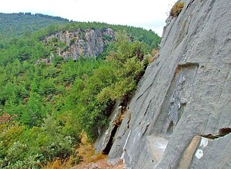 "İzmir - Karabel rock-carving of the Luwian local leader ""Tarkasnawa, King of Myra"" is near Kemalpaşa, a few kilometres to the east of İzmir."