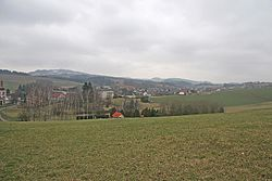 View of Nová ves nad Popelkou of the hill above the cemetery, in the background Mount Tabor