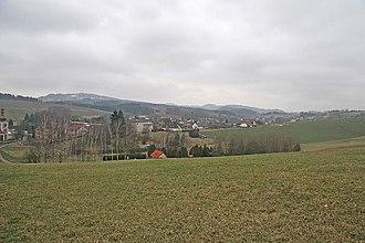 Nová Ves nad Popelkou - View of Nová ves nad Popelkou of the hill above the cemetery, in the background Mount Tabor
