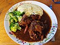 Oxtail stew, mashed potato and broccoli (36249955535).jpg
