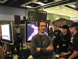 Audiosurf - Dylan Fitterer, the creator of Audiosurf, in front of the game's booth at PAX 2008.