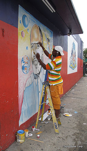 Little Haiti - Portrait of Father Gérard Jean-Juste on a gable wall by Serge Toussaint in Little Haiti.