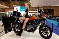 Paris - Salon de la moto 2011 - Suzuki - Hotesse sur une V Strom DL 650 - 001.jpg