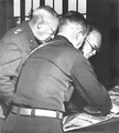 Patton confers with Eisenhower.png