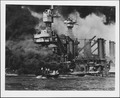 Photograph of a small boat rescuing a seaman from the burning USS West Virginia in Pearl Harbor - NARA - 306532.tif