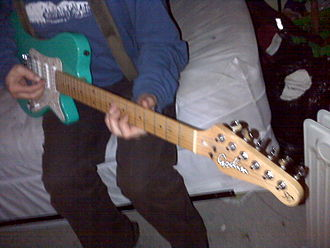 Godin (guitar manufacturer) - Picture of a Canadian man playing a Godin SD Electric Guitar.