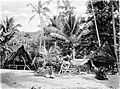 Picturesque New Guinea Plate XXXV - Native Houses and Graves at Suau, Stacey Island.jpg