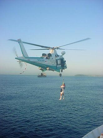Maritime pilot - A pilot preparing to board a vessel by helicopter outside Durban Harbour in South Africa